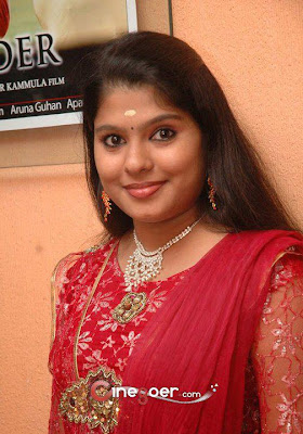 Homely Telugu girl in loose long hair style.