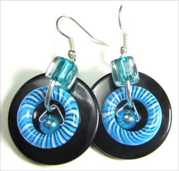 Cool earrings combine swirl donut beads, shiny accent beads and big fashion buttons