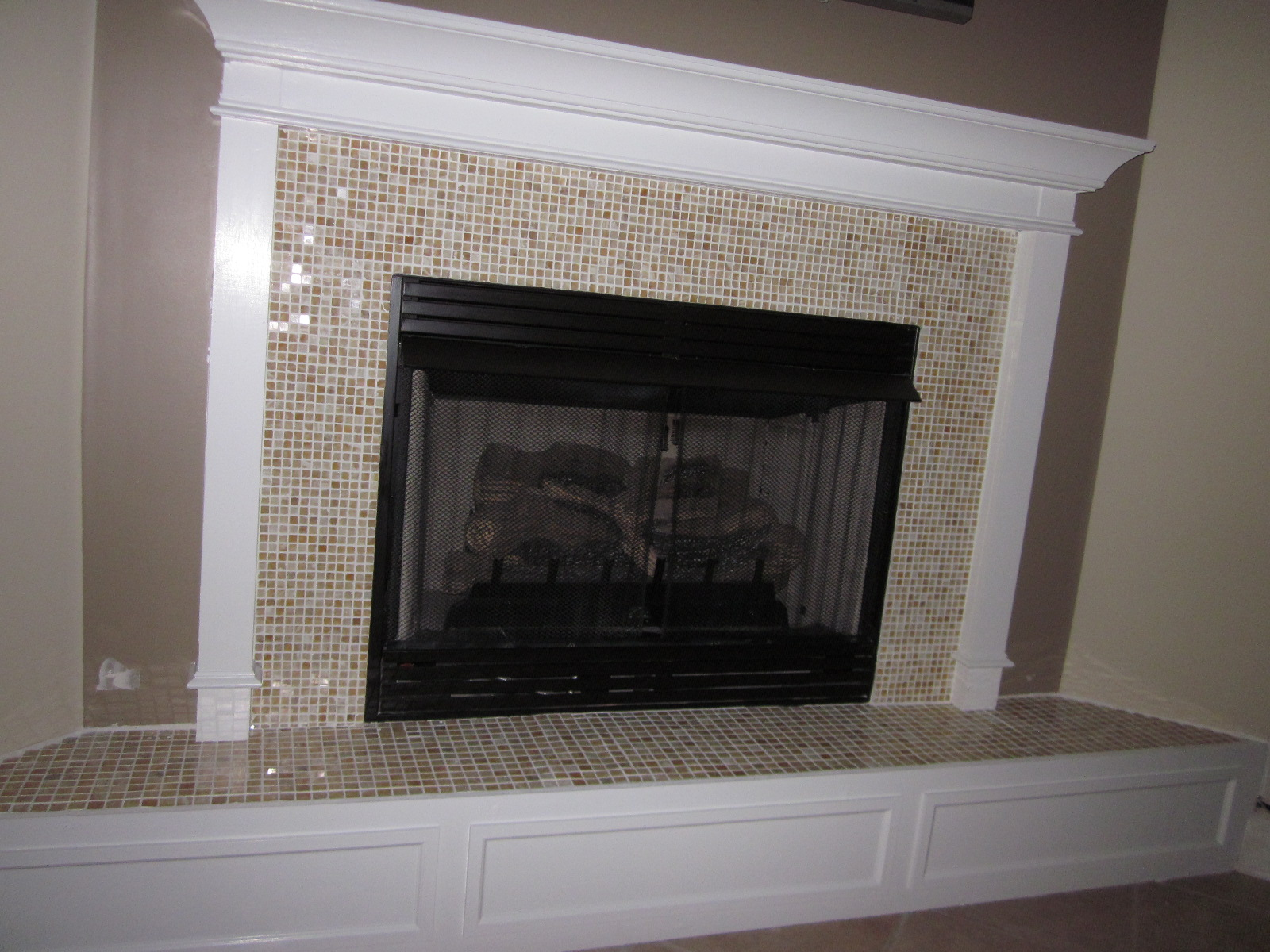 Painting ceramic tile fireplace surround fireplace mini facelift ceramic tile fireplace surround by lipstick and a brad nailer are the only essentials dailygadgetfo Images