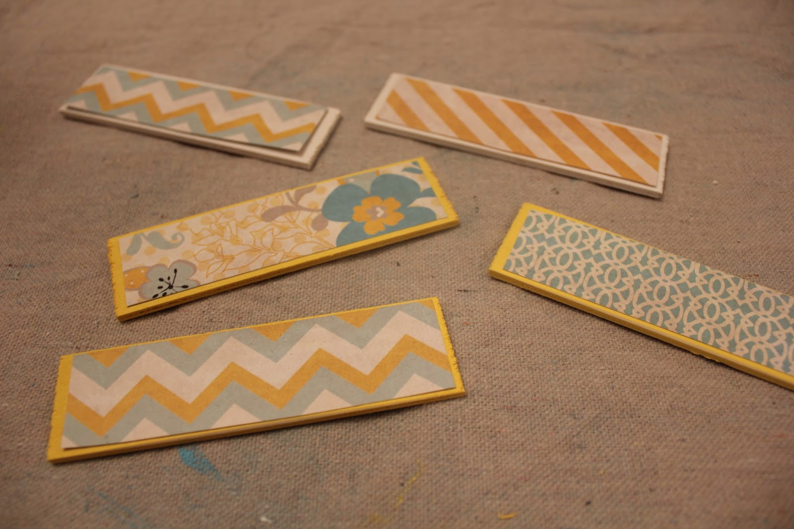 How to put scrapbook paper on wood - I Then Painted All The Tag Wood Pieces That I Would Be Adding To The Block Once Those Were Dry I Cut Out Some Scrapbook Paper And Added Those To One Side