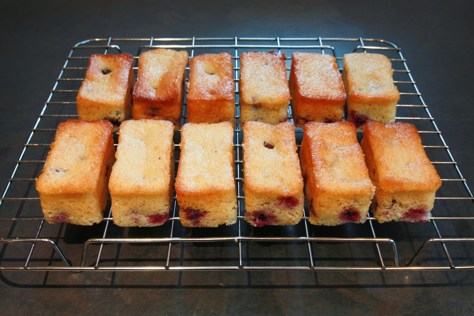 Blackberry and yoghurt mini loaf cakes on a wire cooling rack