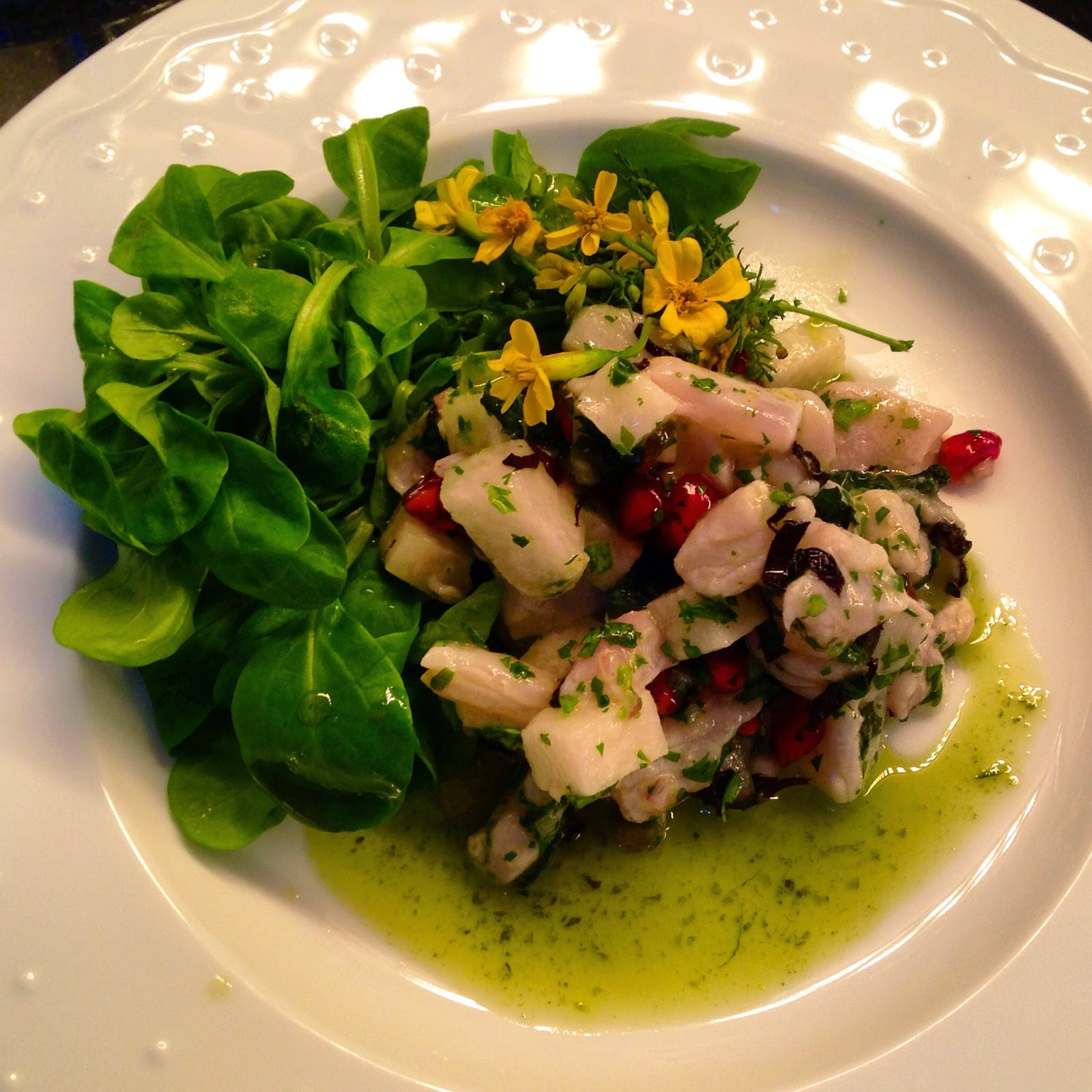 Striped bass ceviche with holy basil, pomegranate, mache, and herb oil