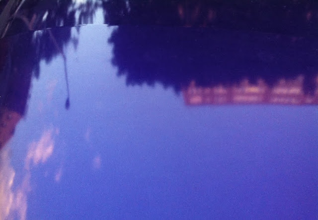 reflection in hood of blue car, washington heights, NY © Amber Schley Iragui 2012