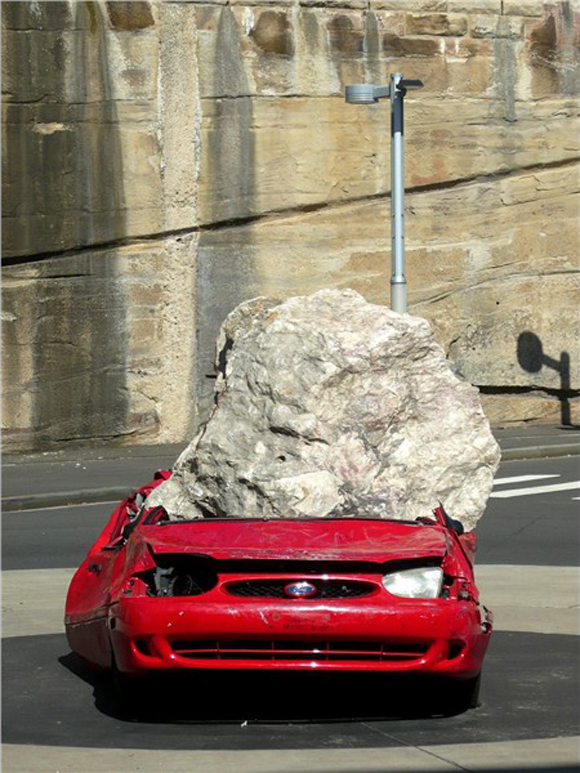 Ford Festiva Crushed Art Car - Still life with stone and car