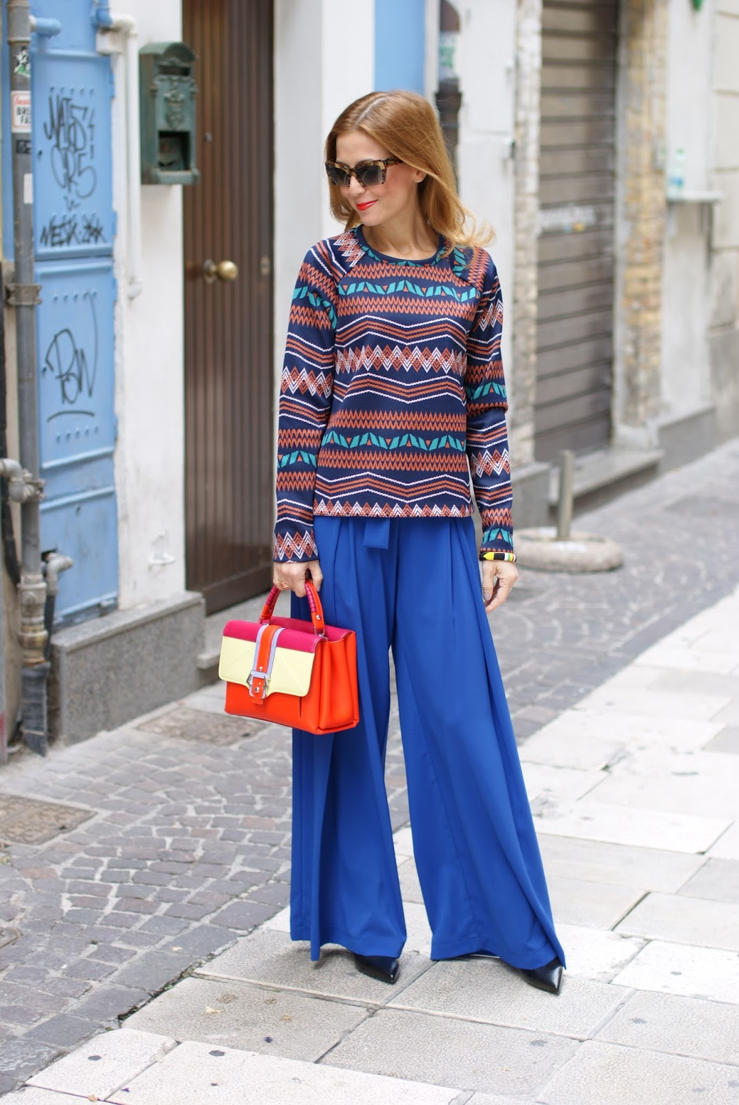 Colorful outfit with wide leg c.j. love palazzo pants and Paula Cademartori Petite Faye bag on Fashion and Cookies fashion blog, fashion blogger style