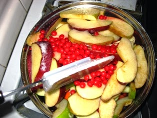 Cooking apples with red hot candy