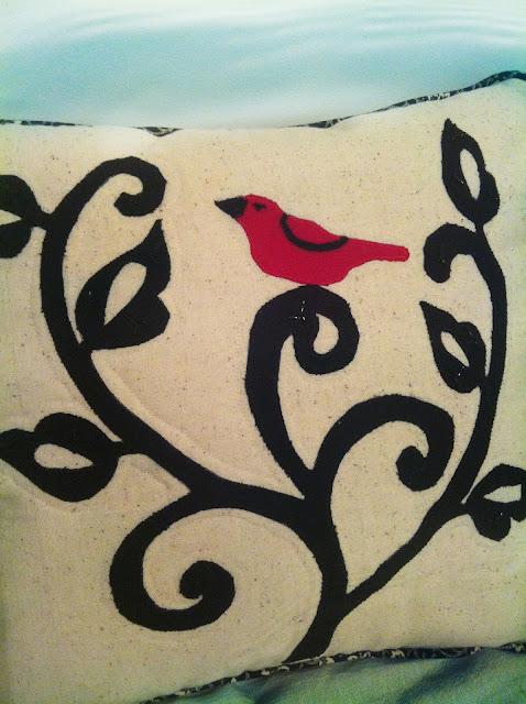 Red bird on pillow