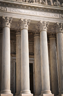 Columns outside a court building with equal justice for all written in the marble.