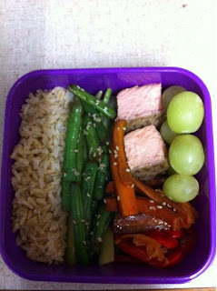 Bento box #1: brown rice, sesame/soy green beans on top of celery kinpira, salmon cubes, carrot kinpira, sweet pepper and onion confit, and fresh grapes