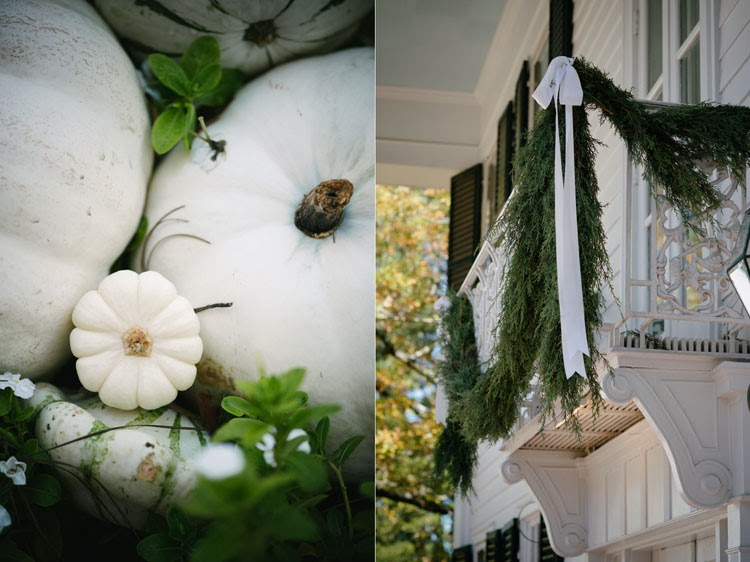 white wedding pumpkins and beautiful lush garland over balcony