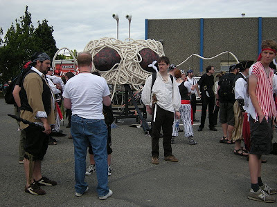Picture of a gathering of atheists with a giant Flying Spaghetti Monster in the background.