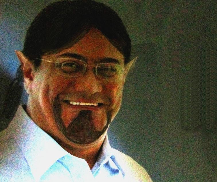 Foto de um candidato com rabiscos fazendo uma barba. Foi feito um rabo de cavalo no cabelo. A ponta superior das orelhas foram levantadas, fazendo-o parecer com um doende.