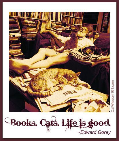 Edward Gorey relaxing among hundreds of books with his cat