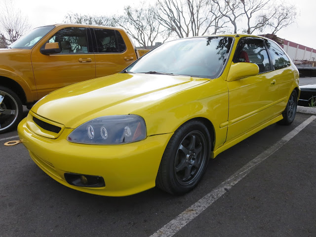 The Screaming Yellow Buzz Bomb Honda Civic Hatchback at Almost Everything Auto Body