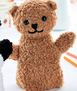 http://www.letsknit.co.uk/free-knitting-patterns/teddy-bear-and-panda-puppets