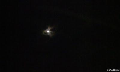 Image: Moon behind clouds