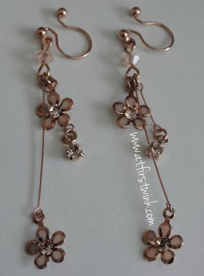 It's Demo rose gold flower earrings