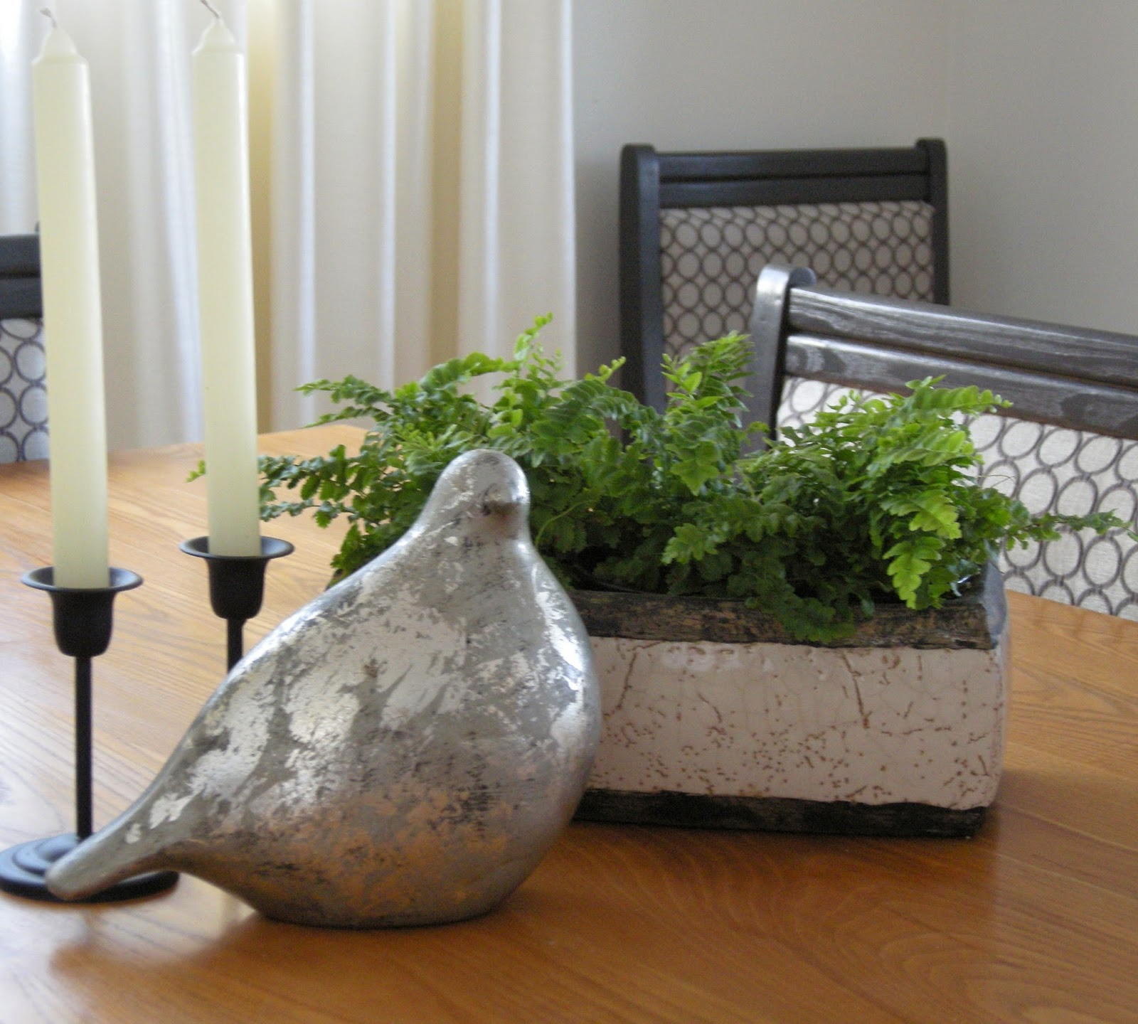 candlesticks, silver leaf bird, trough planter, boston ferns, centrepiece