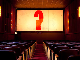 question mark on a cinema screen