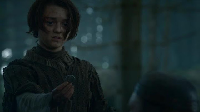 HBO Game of Thrones S03E10: Arya offering the coin.
