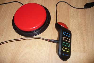 OneSwitch Switch adapted Buzz controller, with Big Red AbleNet Switch.