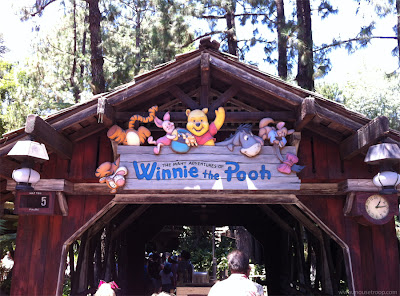 Winnie Pooh ride Disneyland entry sign entrance covered bridge