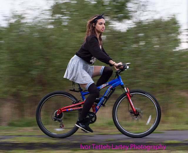 Woman cycling in the Sottish countryside along Roslin Path,Midlothian..