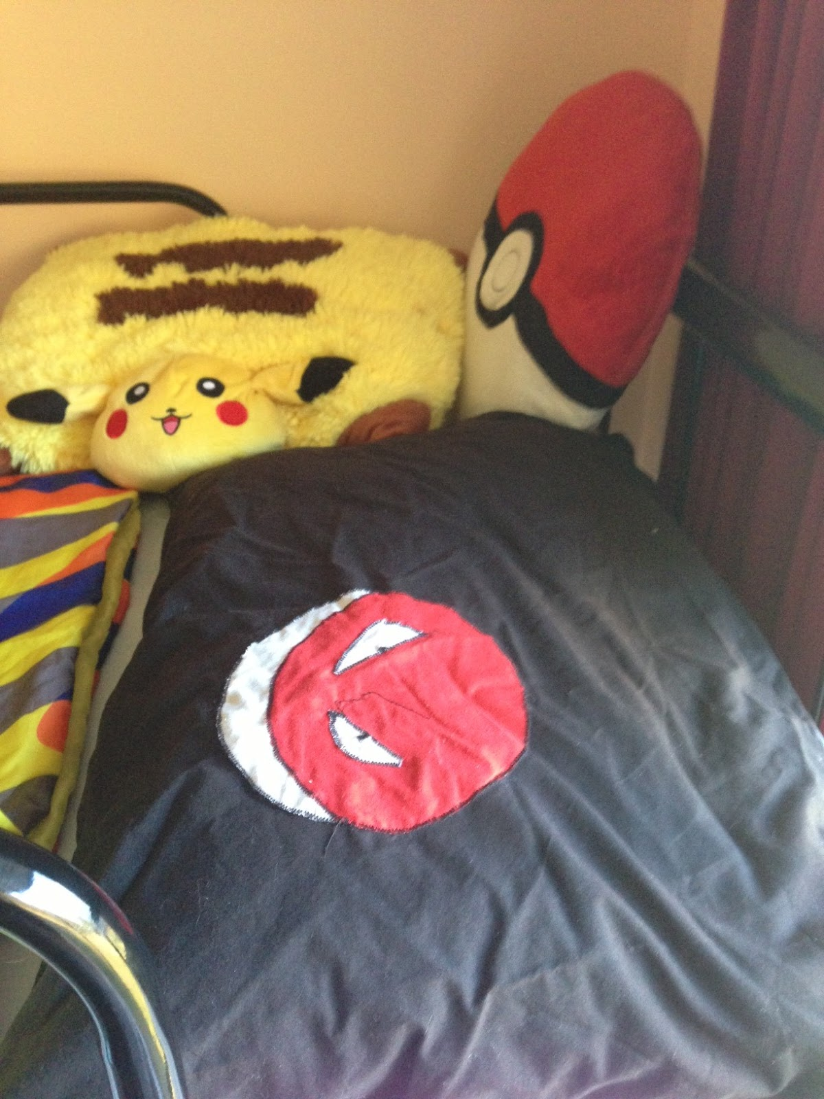 Simple  bed plus his entire plush Pokemon collection There is just enough room for him in his Pokemon sleeping bag with his Voltorb pillow thanks to his