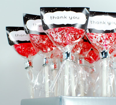 gourmet sweetened grapefruit lollipops in charcoal thank you wrappers