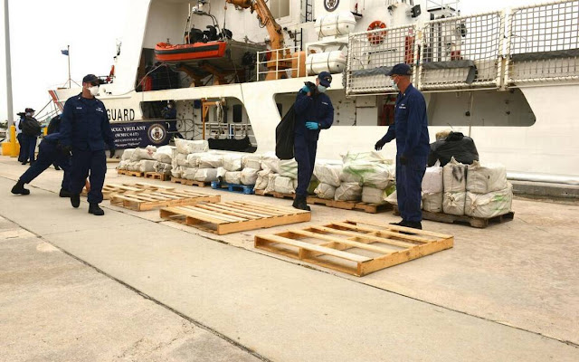 Coast Guard personnel offload intercepted cocaine
