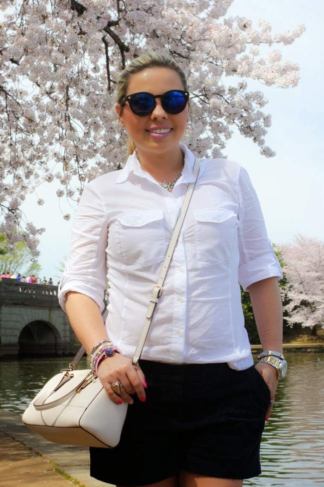 white blouse in front of cherry blossoms