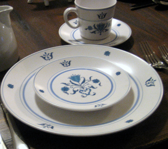 A matching china place setting with a blue and white pattern looks great.