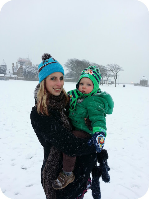 Mother and son in the snow, toddler in snow
