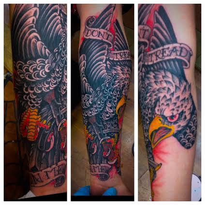 Tattoo of an eagle with quote on banner by tattoo artist Jason Kunz for Triumph Tattoo
