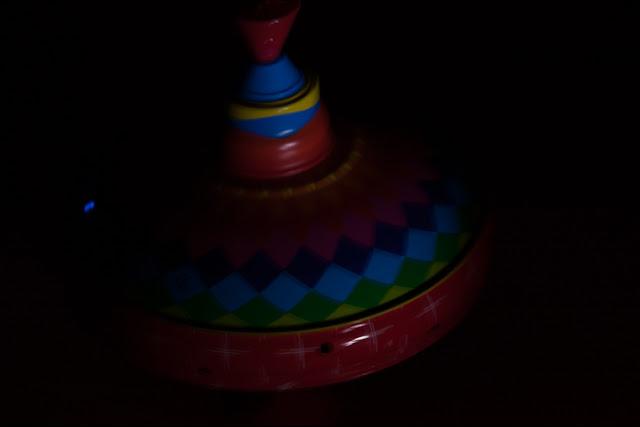 children's colorful top in the dark