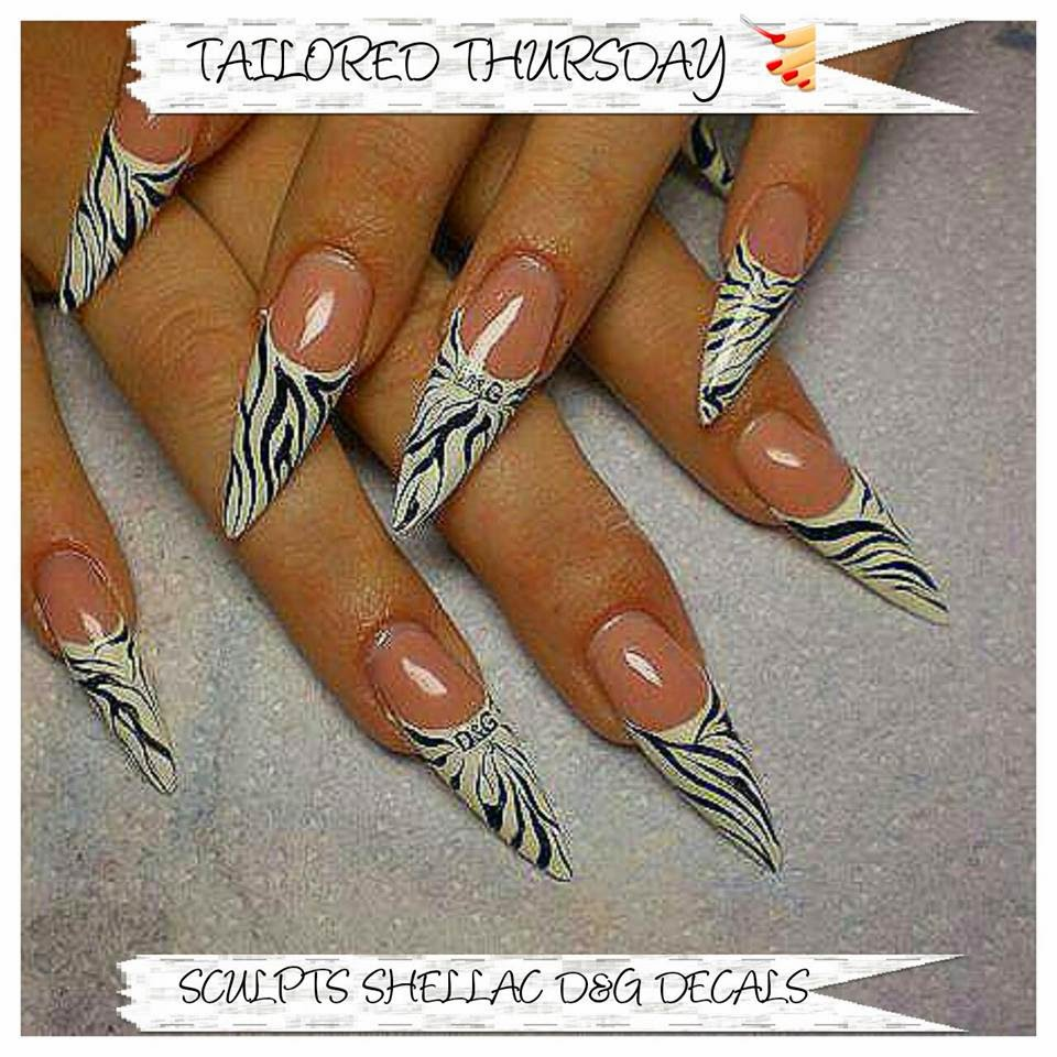 Sculpted acrylics with a Shellac hazing in gold and gold French white gels Shellac manicure extensions stilettos with animal striping