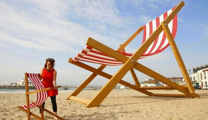 Giant striped chaise lounge on UK beach