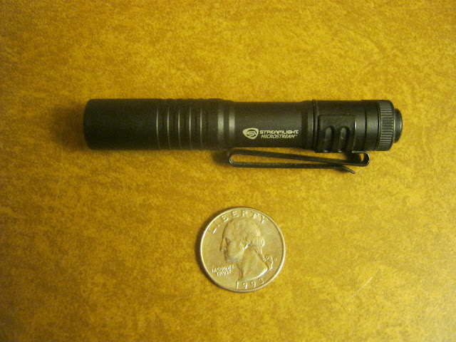 Streamlight Microstream AAA Flashlight shown with quarter for comparison