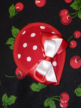 red polka dot fascinator