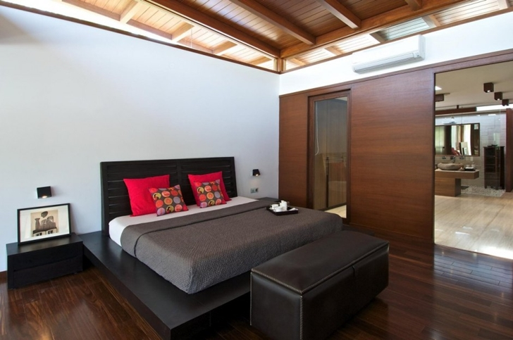 Black bed in Courtyard Home by Hiren Patel Architects