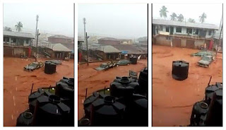 Serious Disaster!!! Watch How Heavy Flood Carry Cars Away In Edo State (See Photos)