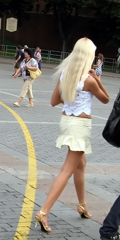 Russian blonde girl in white skirt