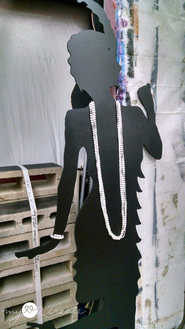 Life sized cut out of a flapper girl wearing pearls