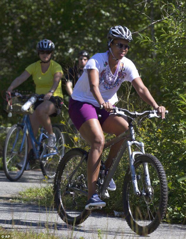 michelle obama riding a bike