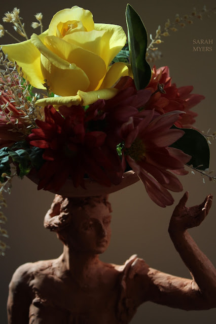woman, sculpture, bowl, figure, terracotta, ceramic, earthenware, red, Sarah, Myers, flowers, lady, escultura, art, arte, clay, bottle, bouquet, rose, chrysanthemums, mums, yellow, orange, new, artwork, classic, figurative, renaissance, artist, tall, beautiful, spontaneous, kunst, move, walk, stride, arrangement, decor, deco, blooms, light, bright, colours, close-up, detail, leaves