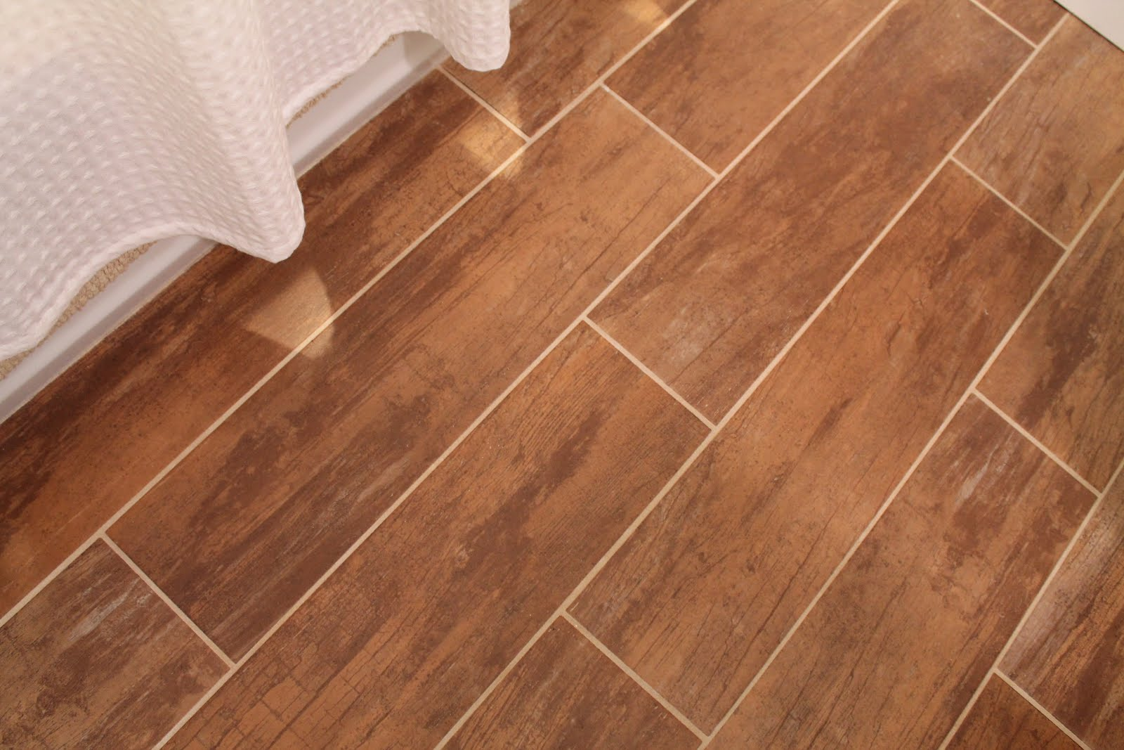 Bathroom renovation with wood grain tile and more for Wooden floor tiles