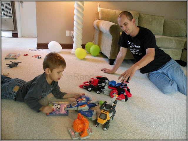 father and son with VTech Dinos