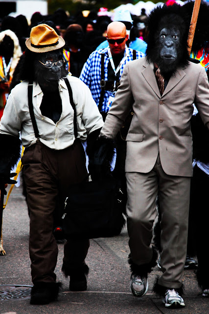 Two gorillas wearing suits with their gorilla masks at the Denver Gorilla Run.