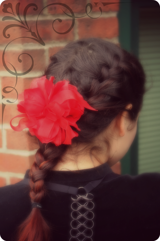 This french braid hairstyle is perfect for gothic lolita or classic lolita, especially with a red rose hair flower!