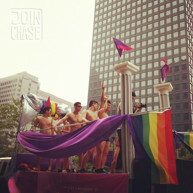 Men dancing on a parade float at the 13th Queer Festival in Seoul, South Korea.